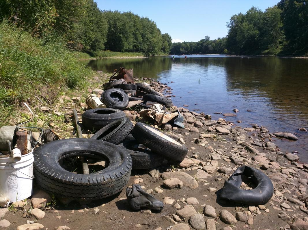 Tires and scrap pulled out of the river