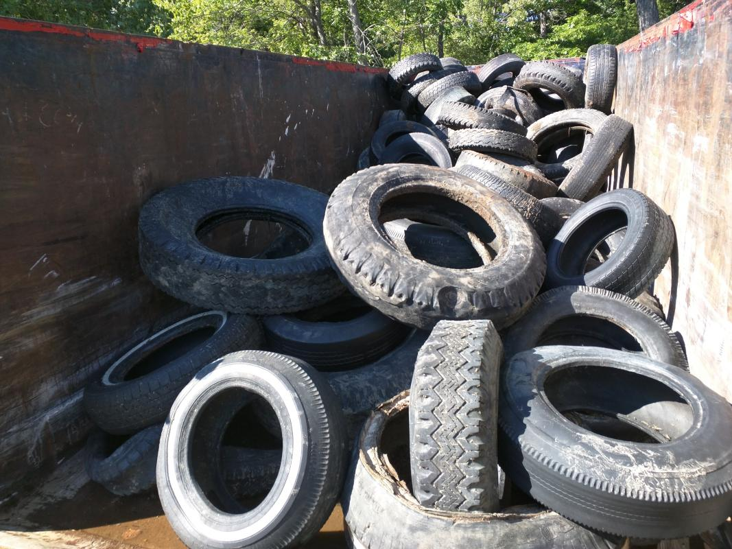 Dumpster filled with tires